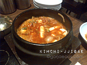 Spicy Korean stew made with fermented kimchi, pork and tofu