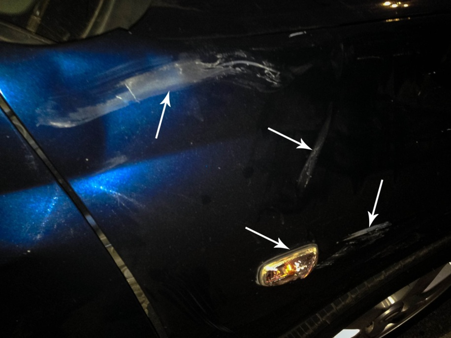 Multiple scratches on the right-hand fender plus broken fender signal light
