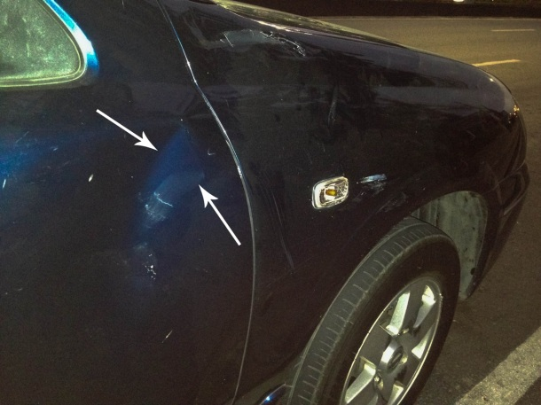 Huge dent on the right-side door, just below the side mirror