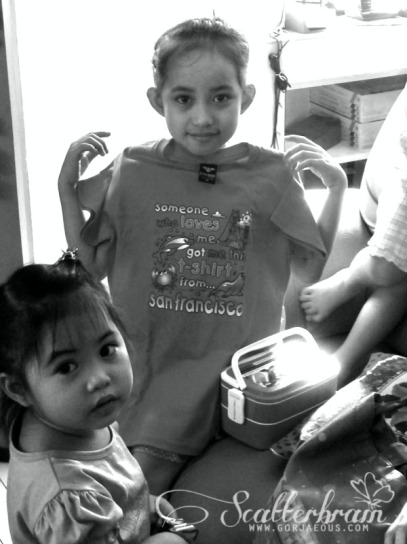 "In this photo: Kassandra with her shirt saying, ""Someone who loves me got me this shirt from San Francisco"", a gift from my Tita Marie; and Kristen, the youngest of three children"